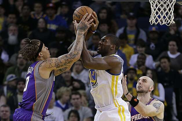 Phoenix Suns' Michael Beasley, left, and Golden State Warriors' Festus Ezeli fight for the ball in the first half of an NBA basketball game Saturday, Feb. 2, 2013, in Oakland, Calif. (AP Photo/Ben Margot) Photo: Ben Margot, Associated Press