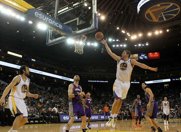 Golden State Warriors forward David Lee (10) shoots aagainst the Phoenix Suns in the first half of their NBA basketball game Saturday, Feb. 2, 2013 at the Oakland Coliseum in Oakland California. Photo: Lance Iversen, The Chronicle