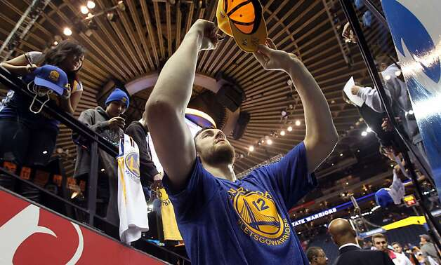 Golden State Warriors center Andrew Bogut signs autographs for the fans prior to the start of their NBA basketball game with the Phoenix Suns Saturday, Feb. 2, 2013 at the Oakland Coliseum in Oakland California. Photo: Lance Iversen, The Chronicle