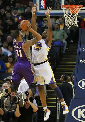 Golden State Warriors forward Carl Landry (7) blocks Phoenix Suns Markieff Morris (11) in the first half of their NBA basketball game Saturday, Feb. 2, 2013 at the Oakland Coliseum in Oakland California. Photo: Lance Iversen, The Chronicle