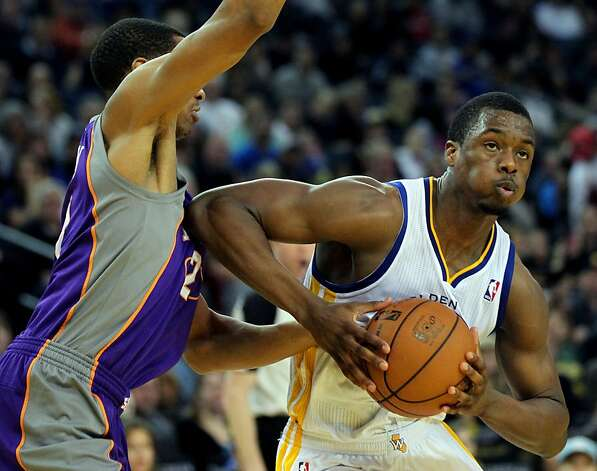 Golden State Warriors forward Harrison Barnes (40) drives to the basket against the Phoenix Suns in the second half of their NBA basketball game Saturday, Feb. 2, 2013 at the Oakland Coliseum in Oakland California. Photo: Lance Iversen, The Chronicle