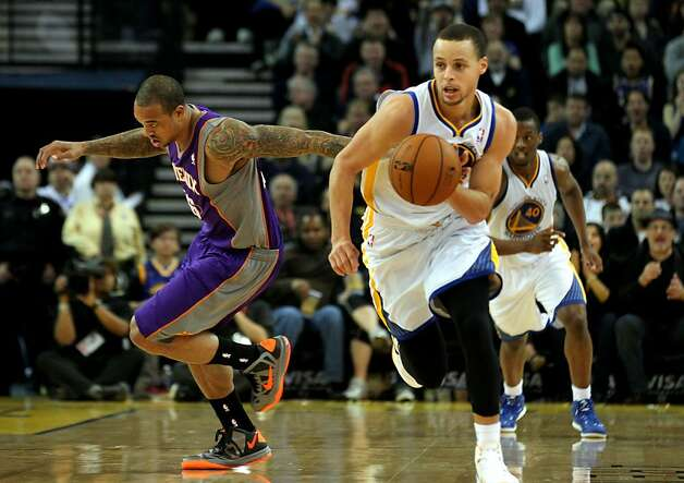 Golden State Warriors guard Stephen Curry (30) runs the fast break after stealing the ball from Phoenix Suns Shannon Brown (26) left, in the second half of their NBA basketball game Saturday, Feb. 2, 2013 at the Oakland Coliseum in Oakland California. Photo: Lance Iversen, The Chronicle