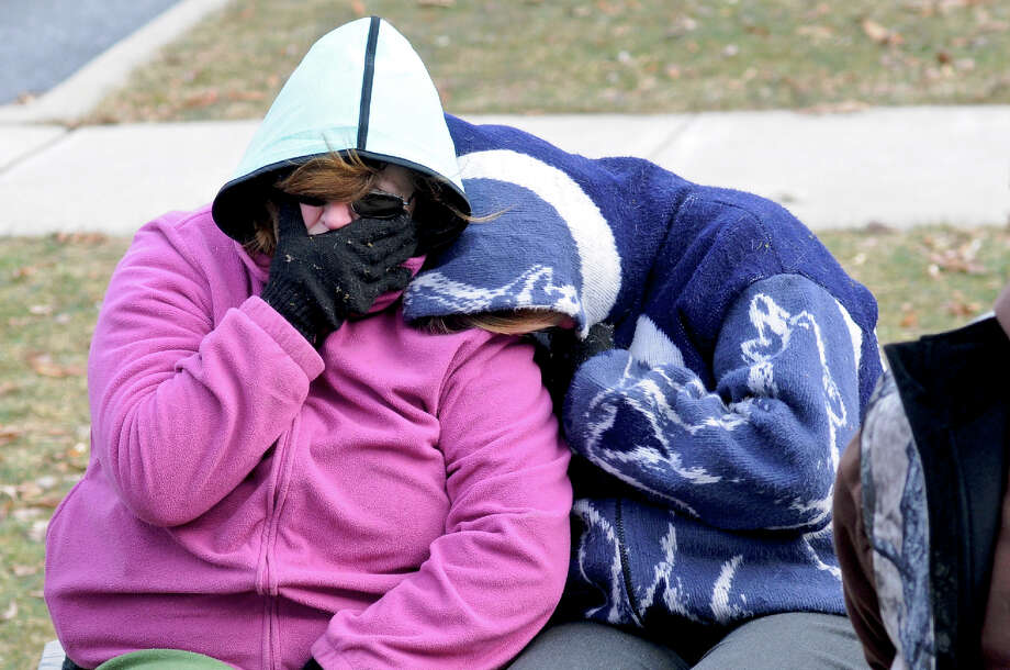 Two unidentified people shelter themselves from the below freezing temperatures after Pine Grove Grundsau Lodge No. 5's stuffed Groundhog Grover and his bride Sweet Arrow Sue predicted six more weeks of winter during the annual Groundhog Day Celebration in Pine Grove, Pa., Saturday, Feb. 2, 2013. Photo: Jacqueline Dormer, AP / The Republican-herald