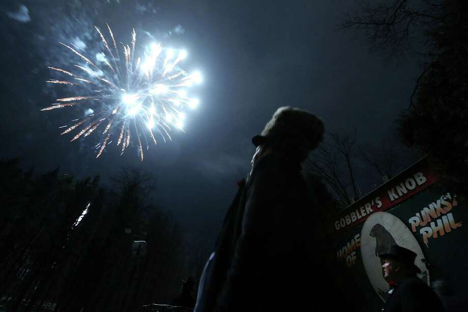 PUNXSUTAWNEY, PA - FEBRUARY 02:  Fireworks are seen during the 127th Groundhog Day Celebration at Gobbler's Knob on February 2, 2013 in Punxsutawney, Pennsylvania. The Punxsutawney 'Inner Circle' claimed that there were about 35,000 people gathered at the event to watch Phil's annual forecast. Photo: Alex Wong, Getty Images / 2013 Getty Images