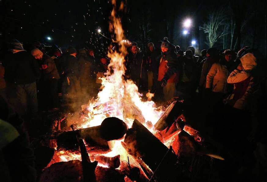 PUNXSUTAWNEY, PA - FEBRUARY 02: A crowd surround a fire to keep themselves warm during the 127th Gro