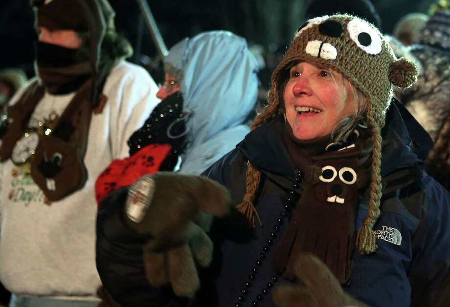 PUNXSUTAWNEY, PA - FEBRUARY 02:  Pam Markin of Dallas, Texas, waits for Punxsutawney Phil to come out from his winter den during the 127th Groundhog Day Celebration at Gobbler's Knob on February 2, 2013 in Punxsutawney, Pennsylvania. Thousands of people gathered at the event to watch Punxsutawney Phil's annual forecast. Photo: Alex Wong, Getty Images / 2013 Getty Images