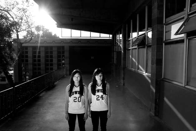 Twin sisters Julia and Cynthia Wong, 16, juniors at Lowell High School on January 29, 2013 in San Francisco, Calif. Cynthia is three minutes older that her sister. Photo: Mike Kepka, The Chronicle / ONLINE_YES