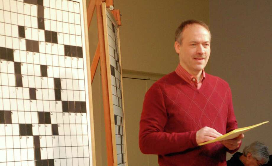 Will Shortz, the New York Times puzzle editor, leads puzzle fans through the competition Saturday at the 14th annual Crossword Puzzle Contest at the Westport Public Library.  WESTPORT NEWS, CT 2/2/13 Photo: Jarret Liotta / Westport News contributed