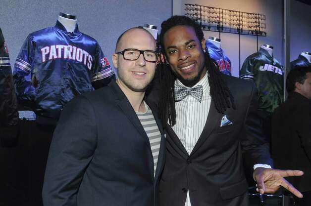 Daniel Hundt and Seattle Seahawks cornerback Richard Sherman attend the Starter Parlor bash. Photo: Vivien Killilea, Getty Images For Starter / 2013 Getty Images