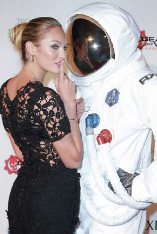 Model Candice Swanepoel attends the Maxim party. Photo: John Parra, Getty Images For AXE / 2013 Getty Images