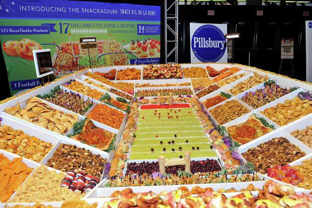 Tonight's MVP just might be someone who can get this Pillsbury snack stadium to someone who's hungry while it is still fresh. Photo: G. Newman Lowrance, Associated Press / AP Images
