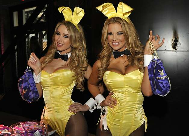 IMAGE DISTRIBUTED FOR CROWN ROYAL - Playboy Playmates Tiffany Toth, left and and Jessa Hinton stuff  Crown Royal camo care packages for U.S. troops overseas during the Playboy Party presented by Crown Royal, Friday, Feb. 1, 2013, in New Orleans. The packages will be shipped as part of the Crown Royal Heros Project honoring American soldiers. (Photo by Jack Dempsey/Invision for Crown Royal/AP Images) Photo: Jack Dempsey, Associated Press