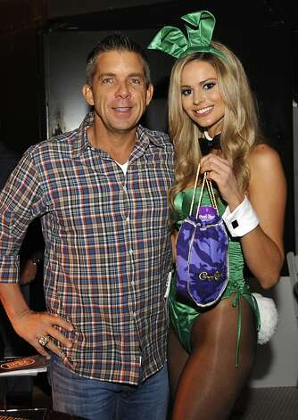 IMAGE DISTRIBUTED FOR CROWN ROYAL - New Orleans Saints head coach Sean Payton stuffs a Crown Royal camo care package for U.S. troops overseas during the Playboy Party presented by Crown Royal, Friday, Feb. 1, 2013, in New Orleans. The packages will be shipped as part of the Crown Royal Heros Project honoring American soldiers. (Photo by Jack Dempsey/Invision for Crown Royal/AP Images) Photo: Jack Dempsey, Associated Press