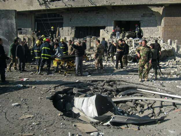 Iraqi civilians and security forces inspect a crater caused by a car bomb attack in Kirkuk, 180 miles (290 kilometers) north of Baghdad, Iraq, Sunday, Feb. 3, 2013. A suicide car bomber joined by other suicide attackers on foot assaulted a provincial police headquarters in a disputed northern Iraqi city killing and wounding scores of people, police said. Photo: AP