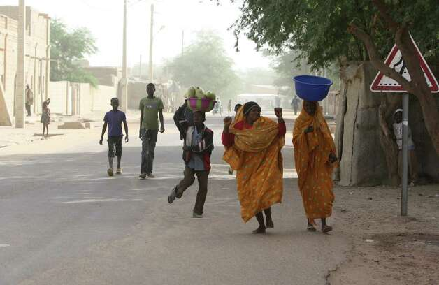 Women dance openly as they walk along a street in Timbuktu, Mali, Thursday Jan. 31, 2013. Many things have changed in Timbuktu since the Islamic militants ceased to enforce their law and relinquished power to French special forces who parachuted in several days ago, liberating this storied city, and now there is a growing sense of freedom. Photo: AP