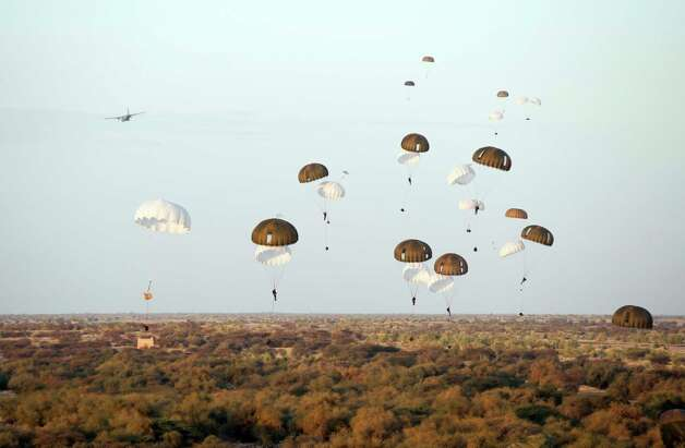 In this photo taken on Tuesday, Jan. 29, 2013, provided by the French Army Communications Audiovisual office (ECPAD) and released Friday, Feb. 1, 2013, French paratroopers drop from a plane over Timbuktu airport as part of the Operation Serval in Mali . France's military intervention in Mali has entered the fourth week, after rapidly forcing Islamists' retreat from major towns. Photo: AP