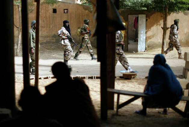 "Chadian troops patrol the streets  in Gao, northern Mali, Tuesday Jan. 29, 2013, days after Malian and French military forces closed in and retook the town from Islamist rebels. Earlier Tuesday, four suspected extremists were arrested after being found by a youth militia calling themselves the ""Gao Patrolmen"". Malian soldiers prevented the mob from lynching them. Photo: AP"