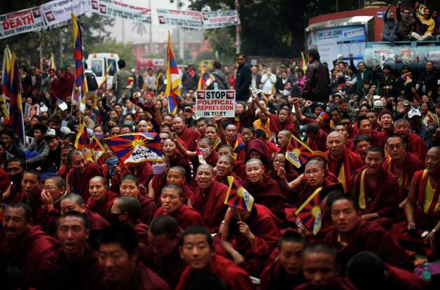 Exiled Tibetan Buddhist nuns shout slogans as they participate in a rally during Tibetan People's Solidarity Campaign in New Delhi, India, Saturday, Feb. 2, 2013. The four-day campaign that began Wednesday is being held to express solidarity with Tibetans inside Tibet and to raise awareness and seek international support for Tibet. Photo: AP