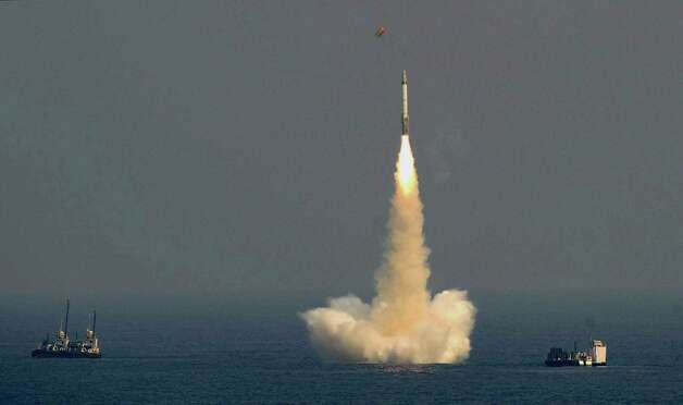 In this Sunday, Jan. 27, 2013 photo, India's ballistic missile, with a range of 700 kilometers (435 miles), is launched in the waters off the Visakhapatnam coast, India. An Indian news report says India has successfully tested a medium-range, nuclear-capable ballistic missile fired from an underwater platform in the Bay of Bengal. (AP Photo)  Photo: AP