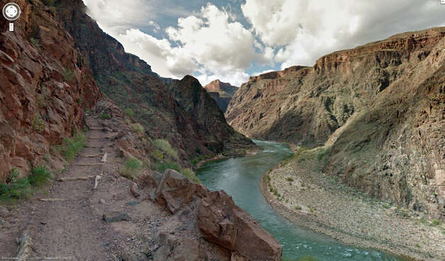 his image provided by Google Maps shows a view from the Grand Canyon and Colorado River in Oct. 2012 in  Arizona. Google now has brought its all-seeing eyes _ mounted for the first time on a backpack _ down into the Grand Canyon, showcasing the attraction's most popular hiking trails on the South Rim and other walkways. Photo: AP
