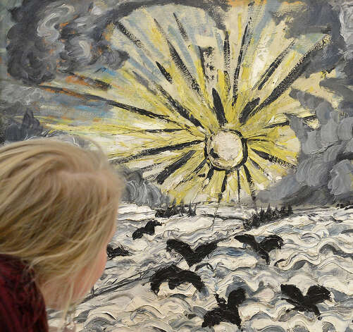 A visitor stands in front of the painting 'Sunrise' (1913, Oil on canvas) of Otto Dix (1891-1969) in the Stadtmuseum (City Museum) of Dresden, eastern Germany, Tuesday, Jan. 29, 2013. It's the first official presentation of the painting, a present to the City Museum in 1920, after the confiscation through the Nazis 75 years ago. Dix, the great German Expressionist, was famous for his unique and grotesque style. Although Hitler's Nazi regime destroyed many of Otto Dix' works, the majority of his paintings can still be seen in museums throughout Germany. Photo: AP