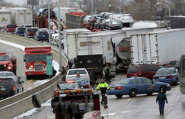 A section of multi-vehicle accident on Interstate 75 is shown in Detroit, Thursday, Jan. 31, 2013. Snow squalls and slippery roads led to a series of accidents that left at least three people dead and 20 injured on a mile-long stretch of southbound I-75. More than two dozen vehicles, including tractor-trailers, were involved in the pileups. Photo: AP