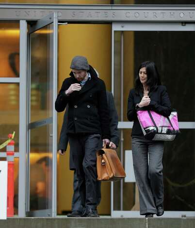 Musician Kasey Anderson, left, walks with his attorney, Corey Endo, Tuesday, Jan. 29, 2013, after Anderson made an initial appearance in U.S. District Court in Seattle. Anderson was arrested on charges he raised more than $525,000 for fictitious music projects - including one that purportedly involved Bruce Springsteen, Willie Nelson and Jack White. Photo: AP