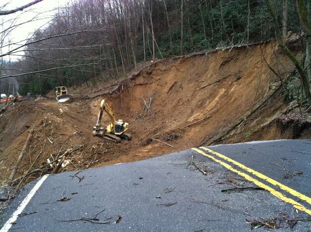 In this photo provided by the Great Smoky Mountains National Park, work to repair a landslide that took out a section of a Smoky Mountains highway between Newfound Gap and Smokemount, Tenn. is underway on Tuesday, Jan. 29, 2013. Photo: AP