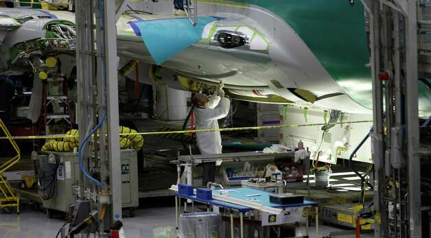 A Boeing Co. worker helps build a next-generation 737 airplane, Tuesday, Jan. 29, 2013, at Boeing's 737 assembly facility in Renton, Wash. Photo: AP