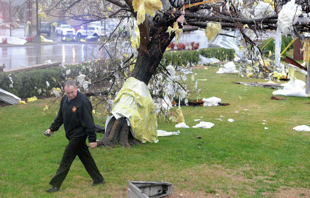 A man walks past debris in trees at a McDonald's on Lebanon Pike in Nashville, Tenn. after a tornado came through on Wednesday, Jan. 30, 2013. (AP Photo/The Tennessean, Shelley Mays)  Photo: AP