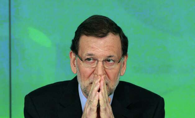 "Spain's Prime Minister Mariano Rajoy gestures during a emergency meeting at the Popular Party headquarters in Madrid, Spain, Saturda. Spain's governing Popular Party insists its financial accounts are totally legal and denies a newspaper report of regular under-the-table payments to leading members, including current Prime Minister Mariano Rajoy. The scandal first broke when after the National Court reported that former party treasurer Luis Barcenas amassed an unexplained euro $30 million in a Swiss bank account several years ago. In a statement Thursday Jan. 31, 2013, the party denied the existence of ""hidden accounts"" or ""the systematic payment to certain people of money other than their monthly wages"". Spain's top prosecutor says there is sufficient cause to investigate fresh allegations of irregular financing of Spain's governing Popular Party and that if necessary Prime Minister Mariano Rajoy would be called in for questioning. Photo: AP"