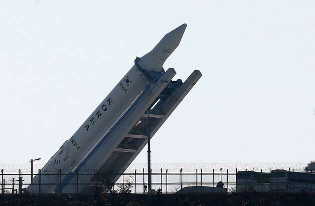 The Korea Space Launch Vehicle-1 (KSLV-1) is lifted from a launch pad at the Naro Space Center in Goheung, South Korea, Monday, Jan. 28, 2013. The rocket is scheduled to blast off on Jan. 30 for the third launch attempt of its first space rocket. (AP Photo/Yonhap, Shin Jun-hee) Photo: AP