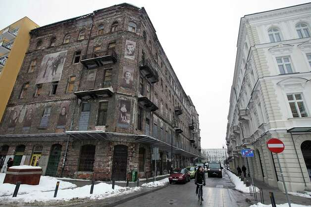Snow covers a street that still boasts four surviving buildings from before World War II in the former Warsaw Ghetto, in Warsaw, Poland, Tuesday. They are some of the very few structures to survive the German onslaught on the Jewish quarter in retaliation for the Warsaw Ghetto Uprising of 1943. Now another building nearby, a simple three-story building which also survived, could be torn down to make way for a tall modern structure. The threatened building belongs to Warsaw's Jewish community, and its leaders say they want to build a taller modern building in its place to accommodate a growing community. That has set up a confrontation with architects and other advocates of historic preservation who want to save it. Photo: AP