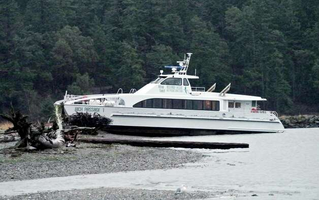 The passenger ferry Rich Passage 1 sits on the beach at Portage Creek near Port Hadlock, Wash., on Monday. The 117-passenger vessel belonging to Kitsap Transit was on its way to Port Townsend, Wash., for haul-out and maintenance when it ran aground overnight. Photo: AP