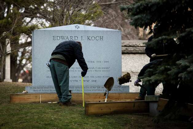 Workers at the Trinity Church Cemetery prepare former New York City mayor Ed Koch's gravesite, Friday in the Washington Heights neighborhood of New York. Koch, who was New York's mayor for three terms from 1978 to 1989, died early Friday morning from congestive heart failure. He was 88 years old. Photo: AP