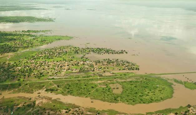 An aerial view shows flood waters in Chokwe, Mozambique, Wednesday. Flood waters have begun receding in Mozambique, and residents have started returning to the worst-hit city with the South African Defence Forces helping deliver food supplies and bedding to affected persons. (AP Photo/Theana Breugem-Foto24) Photo: AP
