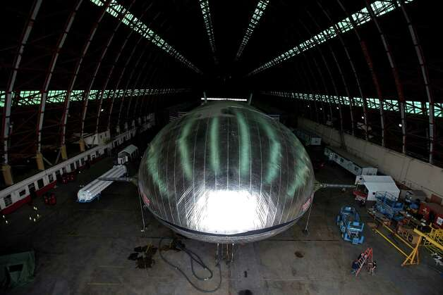 The Aeroscraft airship, a high-tech prototype airship, is seen in a World War II-era hangar in Tustin, Calif., Thursday. Work is almost done on a 230-foot rigid airship inside a blimp hangar at a former military base in Orange Co. The huge cargo-carrying airship is has shiny aluminum skin and a rigid, 230-foot aluminum and carbon fiber skeleton. Photo: AP