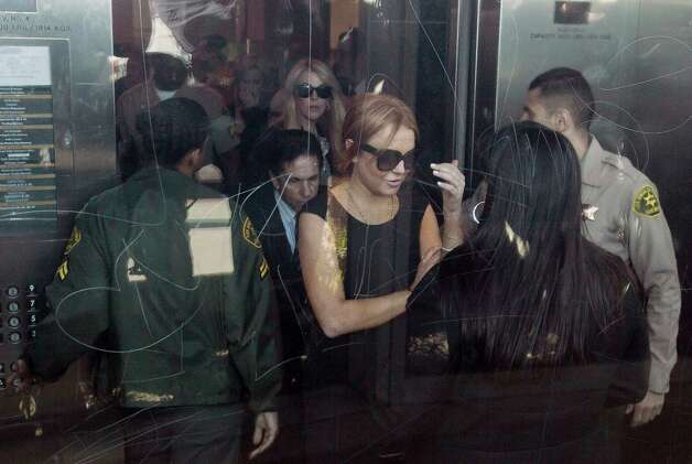Lindsay Lohan is escorted. Photo: AP