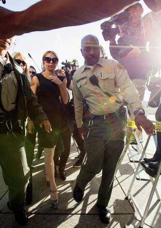 Lohan is escorted by Los Angeles County Sheriffs. Photo: AP