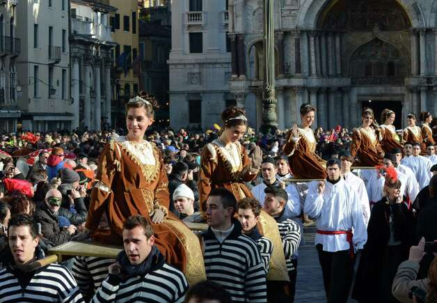 "The ""corteo delle Marie"" (Mary's procession) crosses St. Mark square during the opening day of the Venice Carnival, in Venice, Italy, Sunday. Photo: Luigi Costantini, AP / AP"