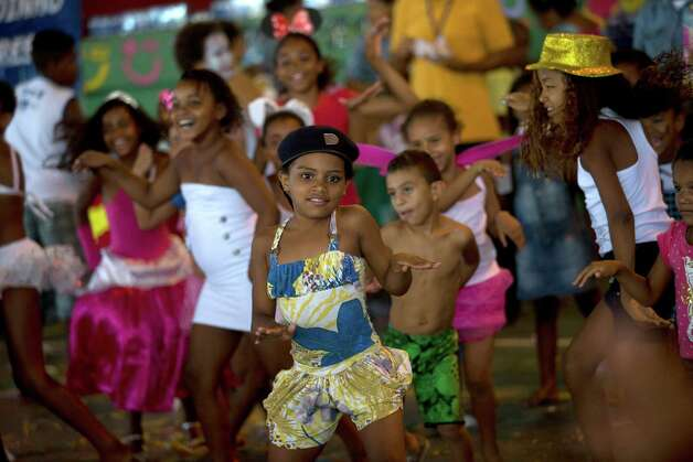 Children dance during a pre-carnival celebration in Rio de Janeiro, Brazil, Friday. Photo: AP