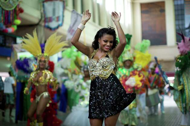 A woman dances at the 'Carnaval na Central' carnival block parade, in central station, during pre-carnival celebrations in Rio de Janeiro, Brazil, Saturday. Photo: AP