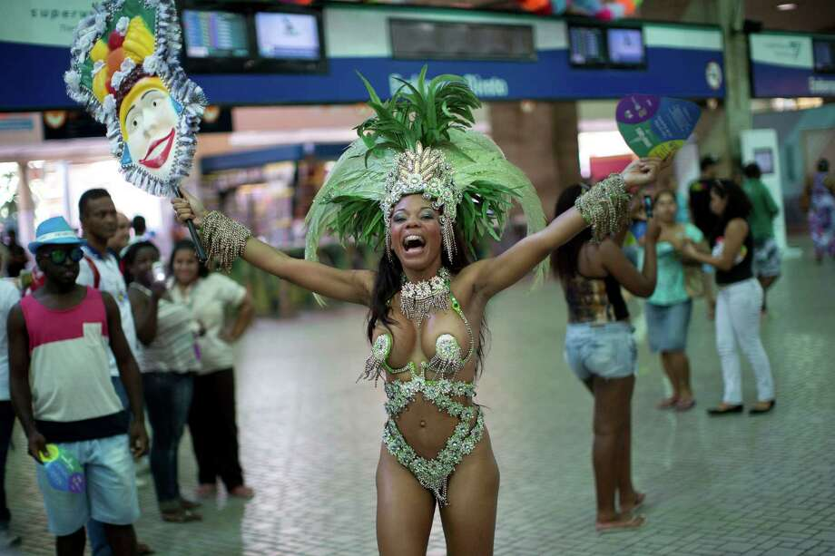 Paulina Reis dances at the 'Carnaval na Central' carnival block parade, in central station, during pre-carnival celebrations in Rio de Janeiro, Brazil, Saturday. Photo: AP