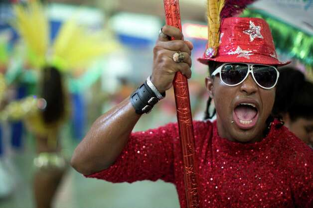 A man dances at the 'Carnaval na Central' carnival block parade, in central station, during pre-carnival celebrations in Rio de Janeiro, Brazil, Saturday. Photo: AP