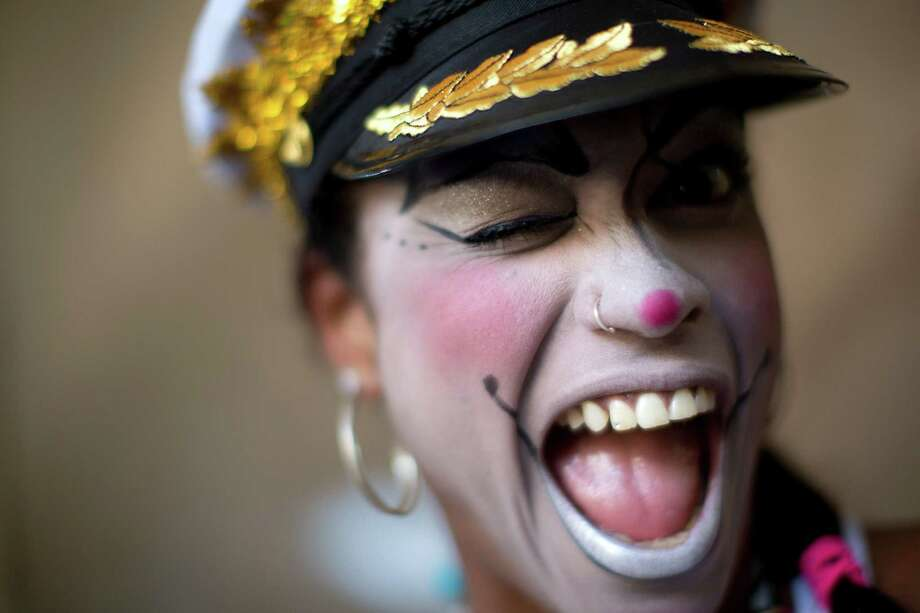 A woman smiles for a photo at the 'Carnaval na Central' carnival block parade, in central station, during pre-Carnival celebrations in Rio de Janeiro, Brazil, Saturday. Photo: AP