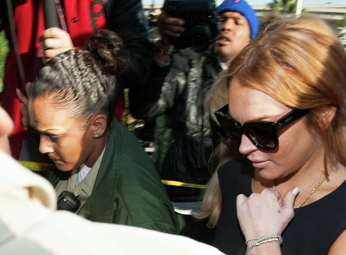 Actress Lindsay Lohan arrives at the Airport Branch Courthouse of Los Angeles Superior Court on Wednesday in Los Angeles, Calif. Lohan is charged with three misdemeanor counts involving a car crash - willfully resisting, obstructing or delaying an officer, providing false information to an officer and reckless driving. She is also accused of violating her probation in a misdemeanor jewelry theft case.Following are some of the many faces of Lundsay Lohan in court.