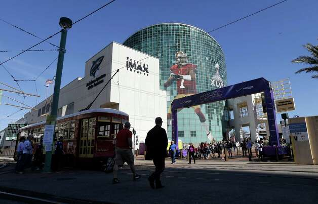 Fans navigate downtown New Orleans. Photo: Jeff Chiu, Associated Press / AP