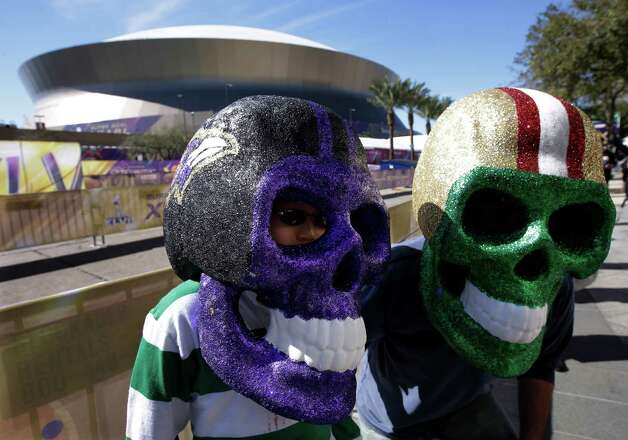 David and Evan Waksman, from New York, pose with skull helmets outside the Superdome. Photo: Mark Humphrey, Associated Press / AP