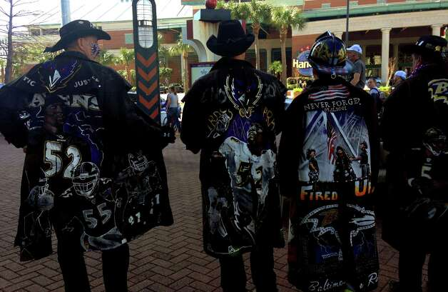Baltimore Ravens fans Rick Bowlus, Greg Thompson, Chip Riley and Brian Donley walk down the street in New Orleans Photo: Nancy Armour, Associated Press / AP