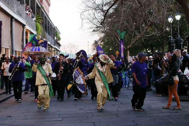 A jazz band marches through the French Quarter near Jackson Square as football fans look on, Saturday, Feb. 2, 2013, in New Orleans. Photo: Julie Jacobson, Associated Press / AP